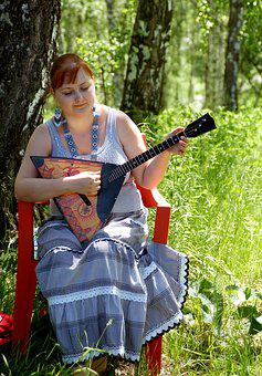 Girl With Balalaika, Musical Instrument