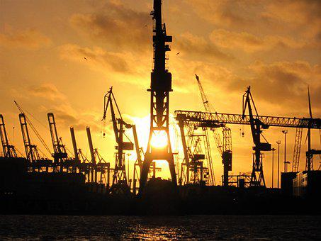 Port Of Hamburg, Harbour Cranes, Sunset With Silhouette