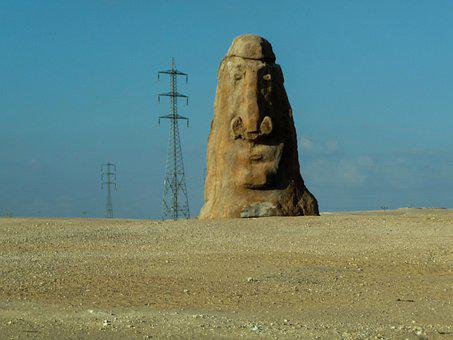 Carved Stone, Rock, Face, Power Lines