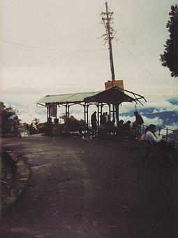 Road, Pavement, Hut, Tables, Chairs, People, Mountains