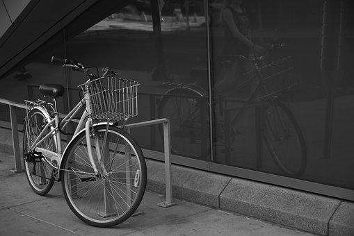 Parked Bicycle, Reflection In A Window