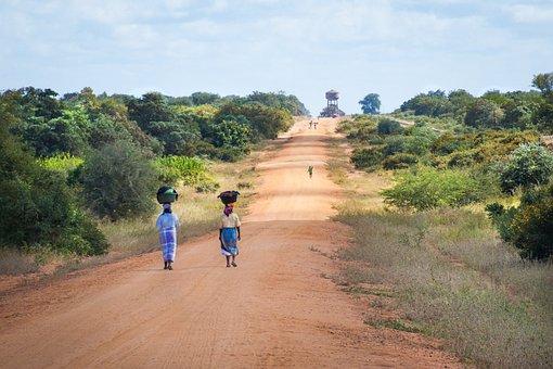 African Women Walking Along Road, Sand Road To Mapai