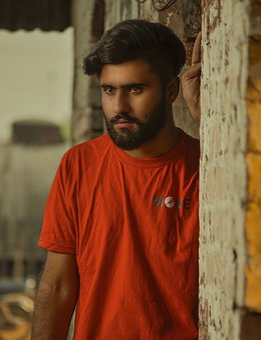 Causal Man, Boy, Stare, Beard, T Shirt, Building