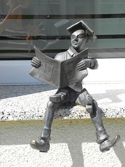 Small Sculpture, Boy, Reading On The Window Sill