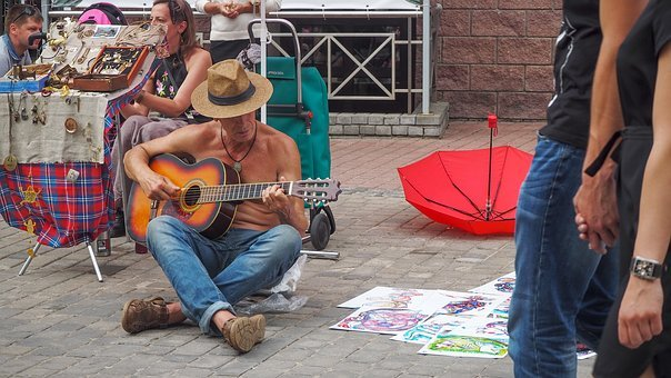 Playing Guitar, Man, Sitting On The Pavement
