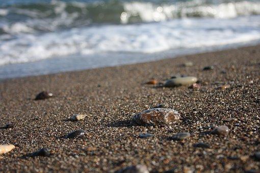 A Mr, Wave, Stone On The Beach