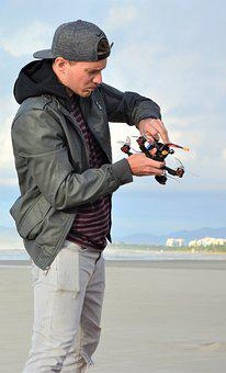Man, Drone, The Pilot Of The Drone, Jacket, Cap, Jeans