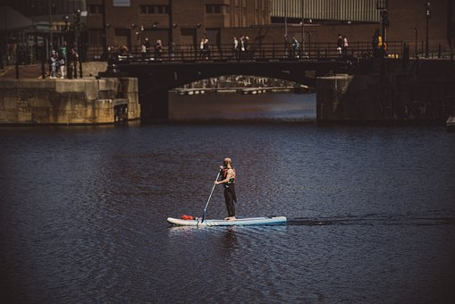 Man Kayaking In Albert Docks, Liverpool, England