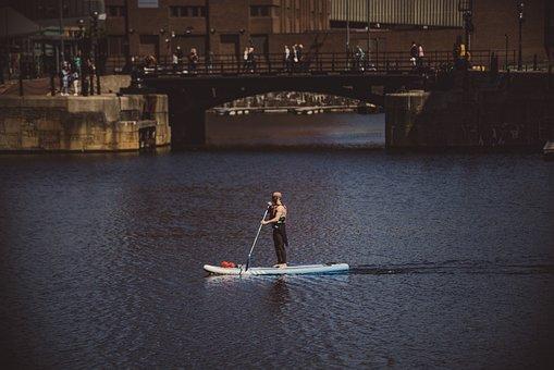Man Kayaking In Albert Docks, Liverpool, England