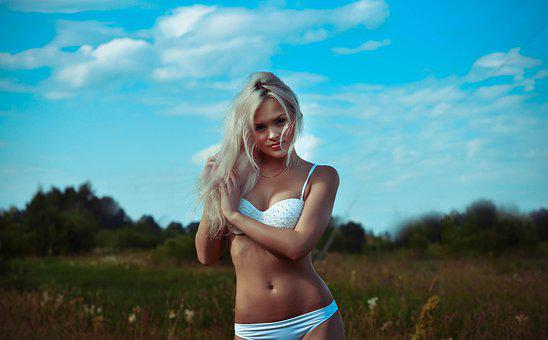 Girls Outdoors, In A White Bathing Suit, Keeps Hair
