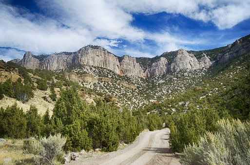 Wyoming, Gravel Road, Rock Formations, Cliffs