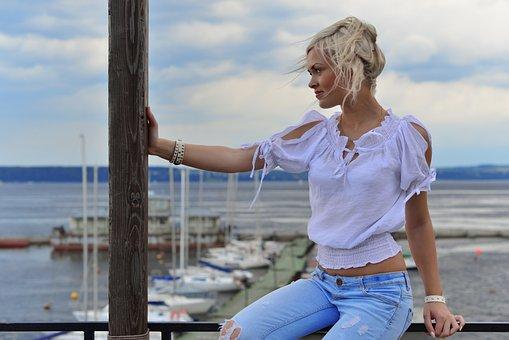 Blonde In Profile, Sky, Water, Blue Jeans