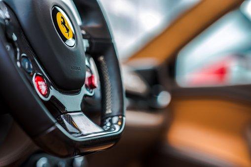 Ferrari Steering Wheel, The Ferrari Logo In Yellow