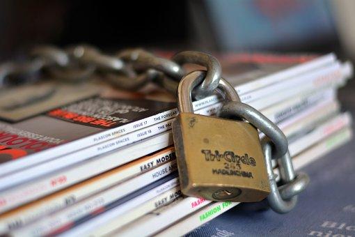Steel Lock, Chain, Magazines, Paper