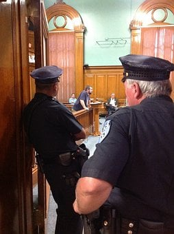 City Council Meeting, Police Officers Watching