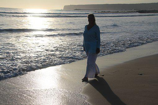 Woman Is Walking On The Beach