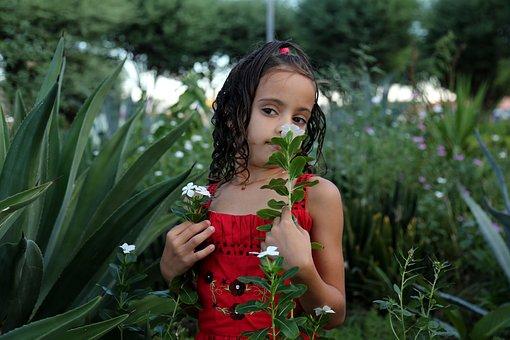 Girl Smelling A Flower, Girl In The Garden, Model