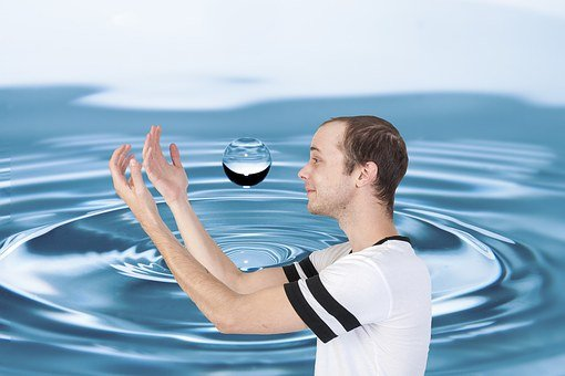 Caucasian Man, Gazing, Into, Water Drop, With, Arms