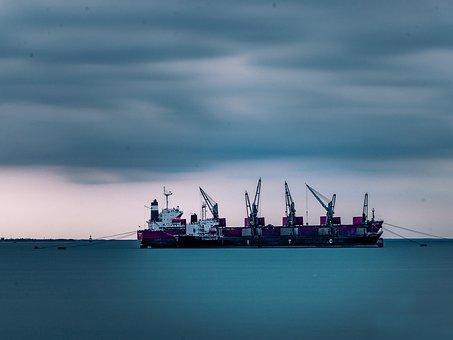 Smooth Sea Surface, Cargo Ship, Blue Sky