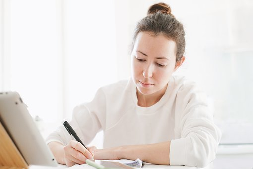 Learning Concept, Young Woman Studying With A Tablet
