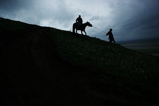 Dark Clouds, Horseback Riding, Hillside, Twilight