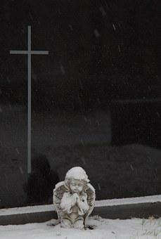 A Praying Angel In Front Of The Headstone