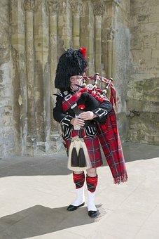 Scottish Piper, Tartan Kilt, Sporran, Military Insignia