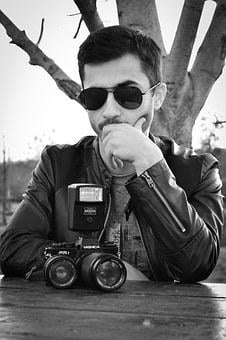 Young Man, Old Camera, Glasses, Serious, Thinking