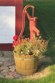 Old Water Pump, Painted Maroon, No Longer Functional
