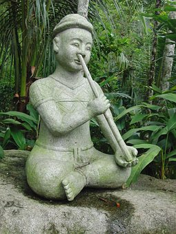 Stone Man, The Man With The Musical Instrument, Sitting