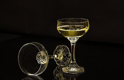 Champagne Glasses, A Full Glass, An Empty Glass