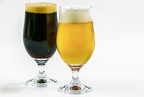 Two Types Of Beer, Dark, Clear, Caramel, Wheat, A Pint
