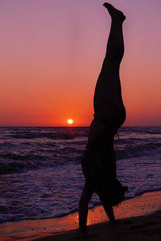 Woman Silhouette Standing On Hands