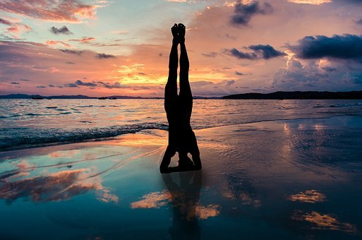 Yoga Stand In Hands Silhouette, Sunset Beach