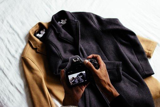 Clothing, Brown, Black, Jacket, Coat, Camera, Hand