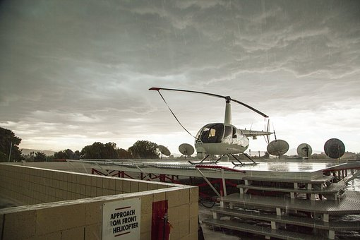 Helicopter In Rain, Stormy Day On Roof